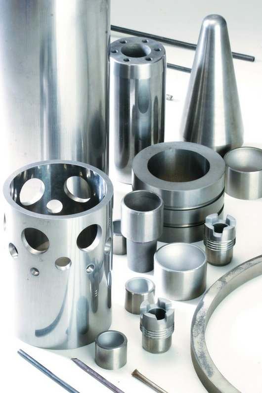 Carbide parts and hardfacing materials for valves